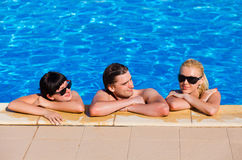Friends in the swimming pool Royalty Free Stock Photo