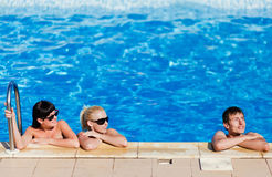 Friends in the swimming pool Stock Photo