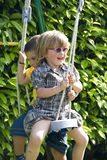 Friends swing. Friends playing on the playground swing Stock Photography
