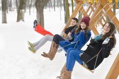 Friends Swinging Stock Photos