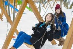 Friends Swinging Stock Photo
