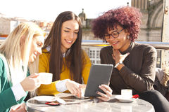 Friends with the tablet. Group of friends with the tablet Royalty Free Stock Photos