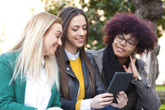 Friends with the tablet Royalty Free Stock Image