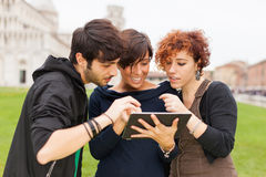 Friends with Tablet PC. Group of Friends with Tablet PC Outside Stock Photo