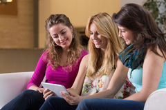 Friends and tablet Royalty Free Stock Photo