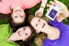 Friends taking photo royalty free stock images