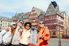 Friends taking photo by selfie stick in frankfurt Stock Photo