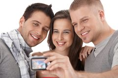 Friends taking photo of themselves Stock Image