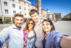 Friends taking photo of themselves. Group of friends taking a selfie royalty free stock photography