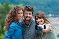Friends taking photo of themselves Stock Photography