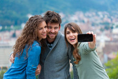 Friends taking photo of themselves Royalty Free Stock Photos