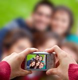 Friends taking a picture Royalty Free Stock Photography