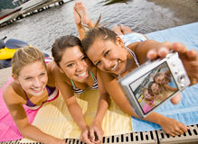 Friends taking picture with digital camera Stock Photo