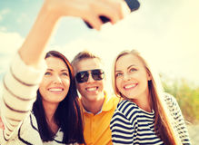 Friends taking picture with smartphone camera Royalty Free Stock Photos