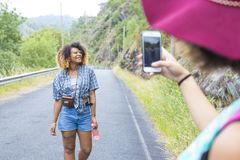 Friends taking pictures. With your mobile phone Royalty Free Stock Photos