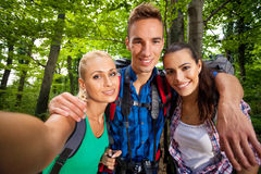 Friends taking pictures during hiking Stock Image