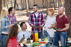 Friends taking pictures together at barbecue Royalty Free Stock Images