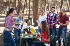 Friends taking pictures together at barbecue Royalty Free Stock Photos