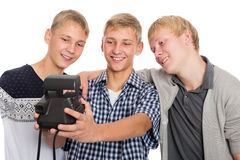 Friends taking self on old camera instant print Stock Photography