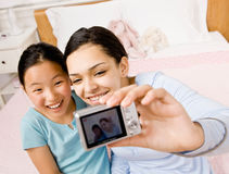 Friends taking self-portrait with digital camera Stock Photos