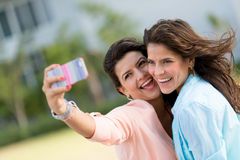 Friends taking a self portrait Stock Images