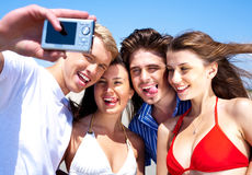 Friends taking self portrait, outdoors Royalty Free Stock Photo