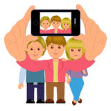Friends taking a self portrait with smartphone. Selfie. Stylish young people with the phone, take a picture Stock Photo