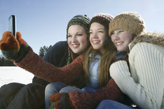 Friends Taking Self Portrait In Winter Royalty Free Stock Images