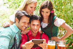Friends taking selfie in bavarian Stock Image