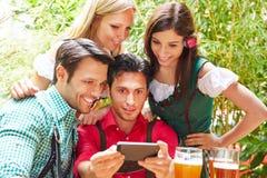 Friends taking selfie in bavarian Stock Image