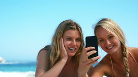Friends taking a selfie. On the beach stock video