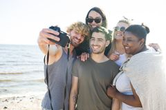 Friends taking selfie on beach Royalty Free Stock Images
