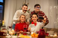 Friends taking selfie at christmas dinner stock images