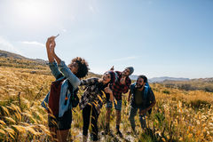 Friends taking selfie on countryside hike Royalty Free Stock Image