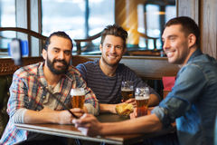 Friends taking selfie and drinking beer at bar Stock Photos
