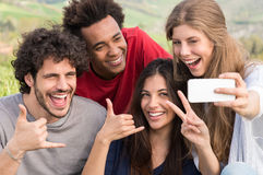 Friends Taking A Selfie With Mobile Phone. Group Of Happy Friends Taking Picture With Mobile Phone Outdoor stock photos