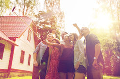 Friends taking selfie at party in summer garden Stock Photo