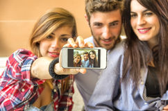 Friends taking a selfie with phone stock images