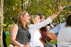 Friends taking a selfie photo at food and wine festival royalty free stock image