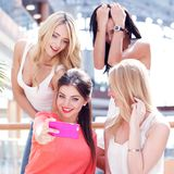 Friends taking selfie in shopping mall Stock Images