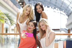 Friends taking selfie in shopping mall Stock Photo