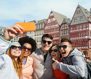 Friends taking selfie by smartphone in frankfurt Royalty Free Stock Photography