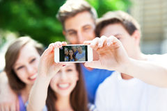 Friends taking a selfie with smartphone Royalty Free Stock Photo