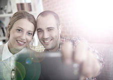 Friends taking a selfie with a smartphone Royalty Free Stock Photography