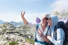 Friends Taking Selfie at Top of Mountain Royalty Free Stock Images