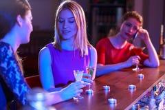 Friends talking at bar Stock Photo