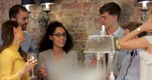 Enjoying Socialising Over Drinks In A Bar