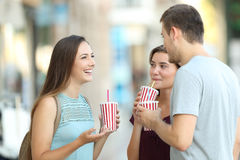 Friends talking and drinking takeaway refreshments Stock Image
