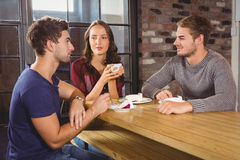 Friends talking and enjoying coffee and cake Stock Images