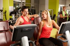 Friends talking in gym Stock Images